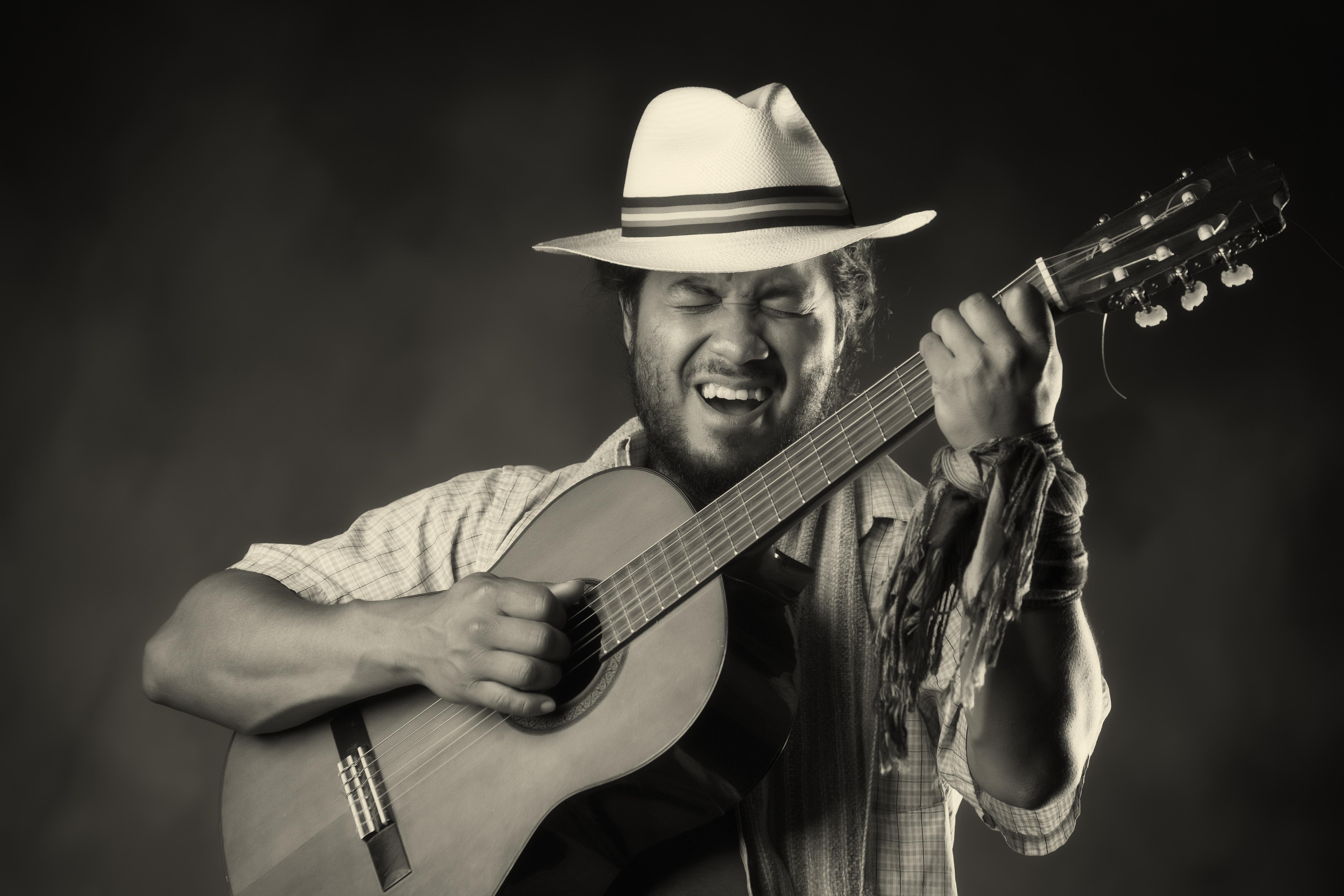 Rastafarian Man Playing Classic Guitar