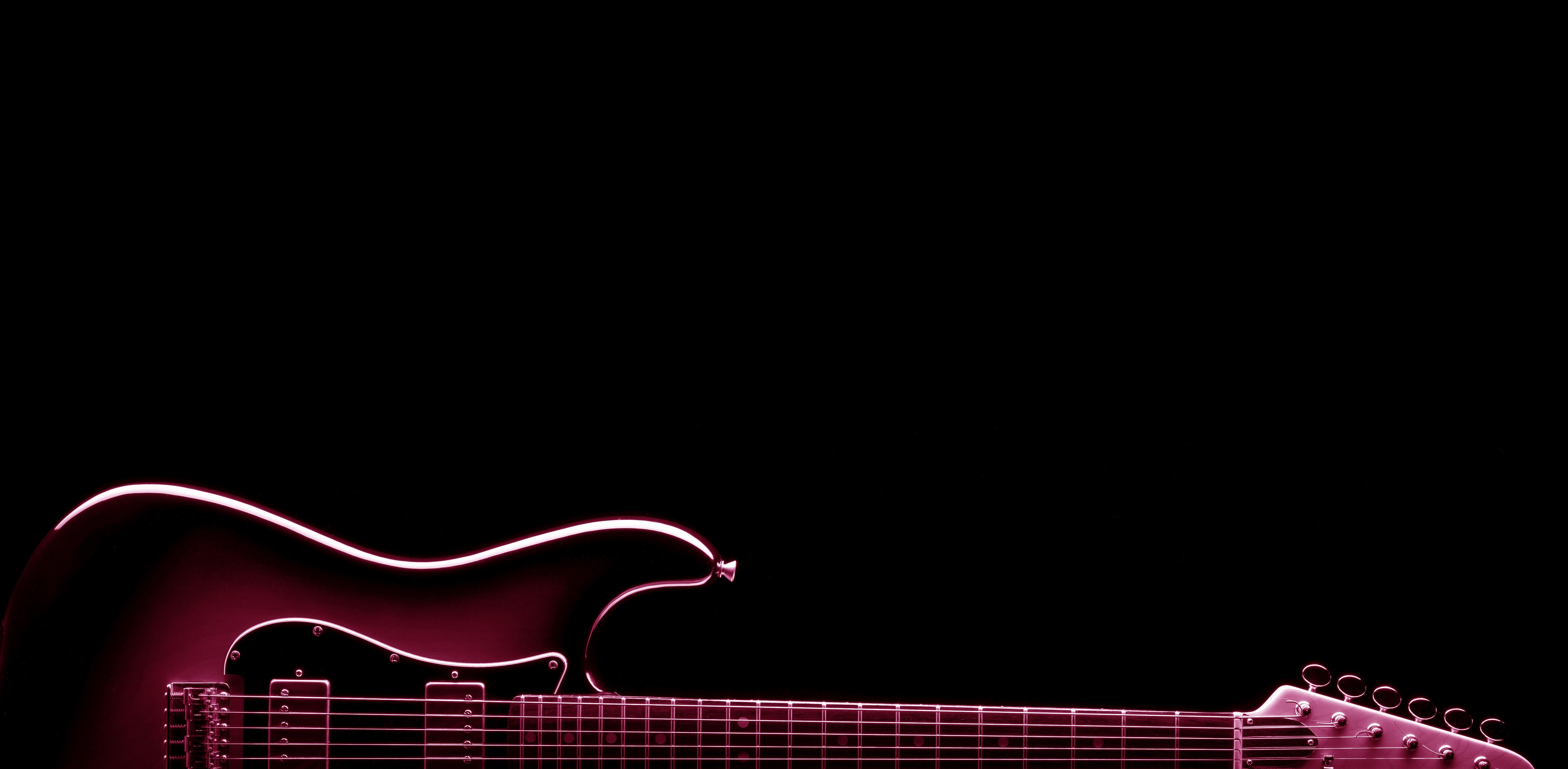 vintage electric guitar shape on black , blue image